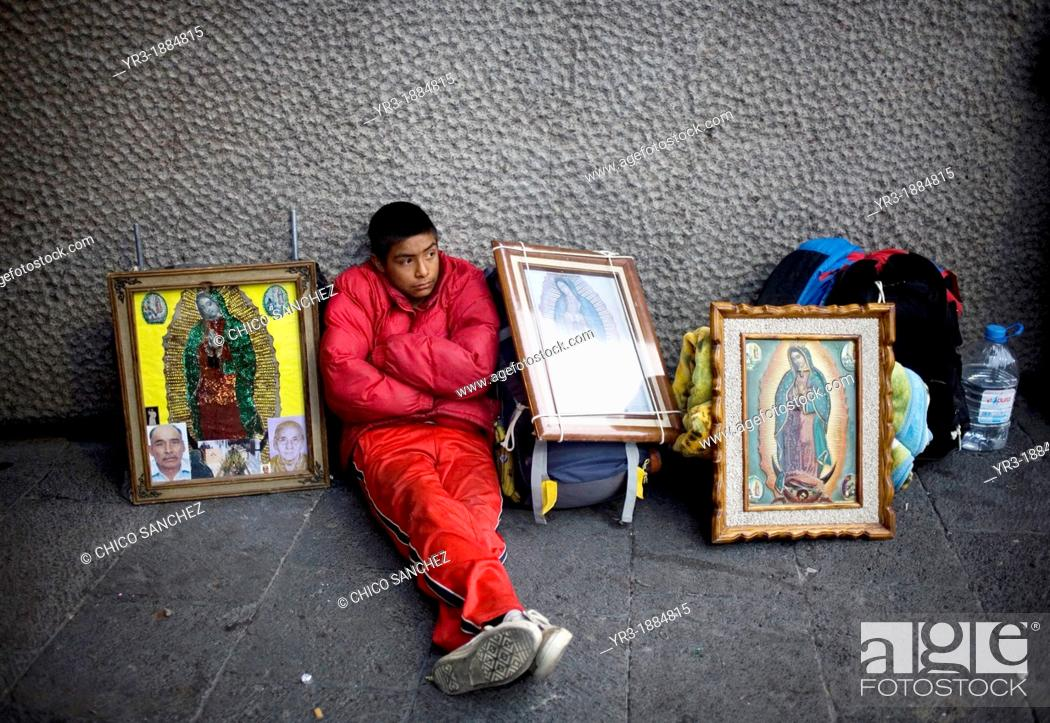 Stock Photo: A pilgrim sits by images of Our Lady of Guadalupe virgin in Mexico City, December 6, 2008  Hundreds of thousands of Mexican pilgrims converged on the Our Lady.