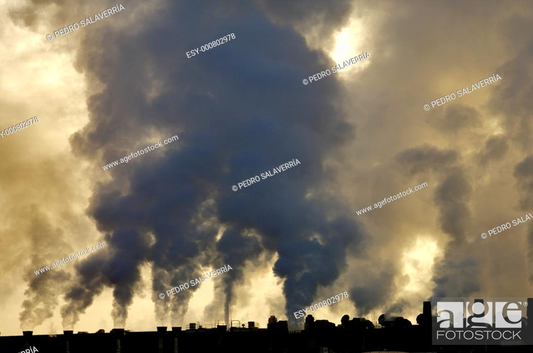 Stock Photo: view of the smoke produced by a polluting industry in Saragossa, Aragon, Spain.