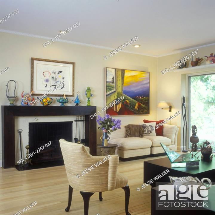 Stock Photo Living Rooms Modern Eclectic Lots Of Original Art Framed On Wall Artsy Teapot Collection Fireplace With One A Kind Teapots