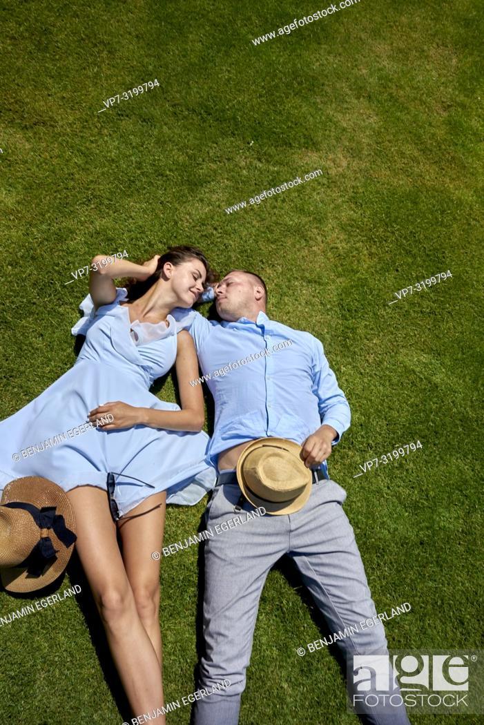 Stock Photo: Couple lying on meadow.