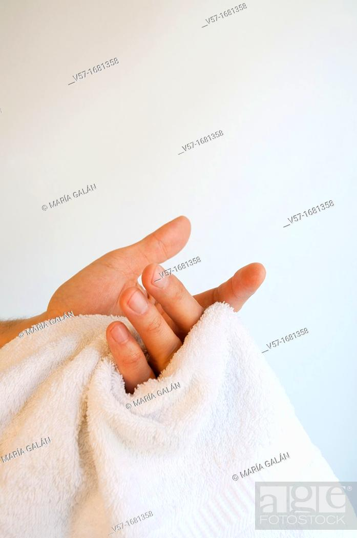 Stock Photo: Man drying his hands with the towels. Close view.