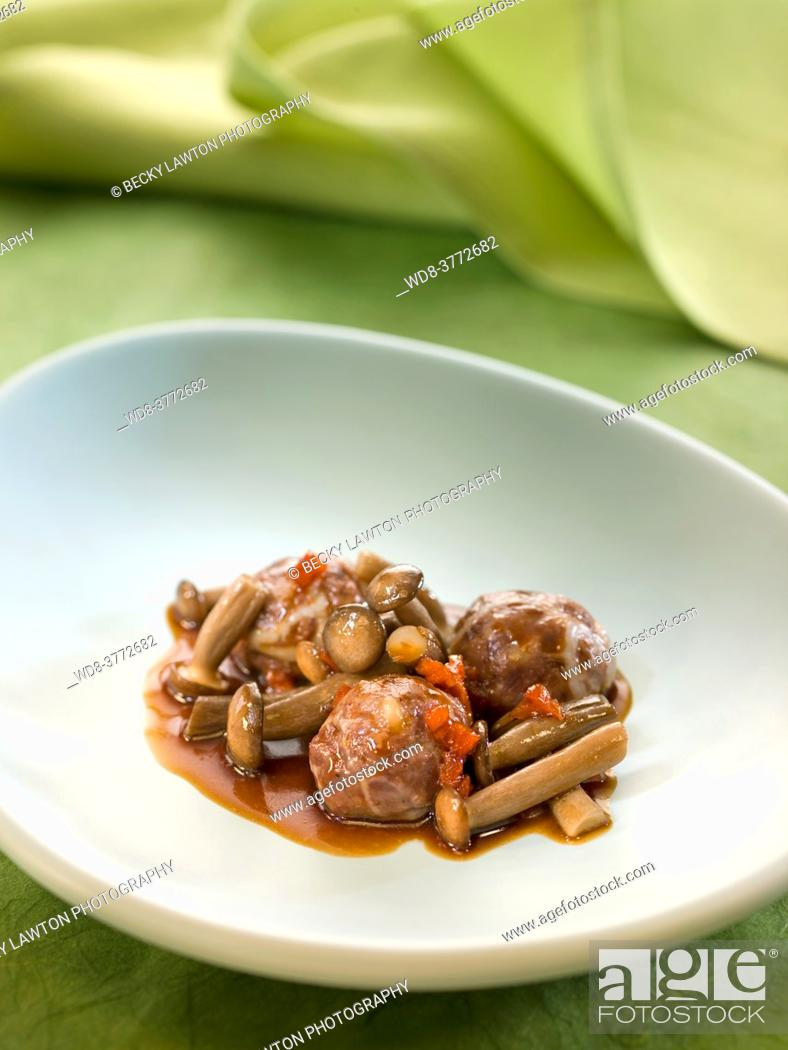 Stock Photo: veal meatballs with pine nuts and mushrooms.