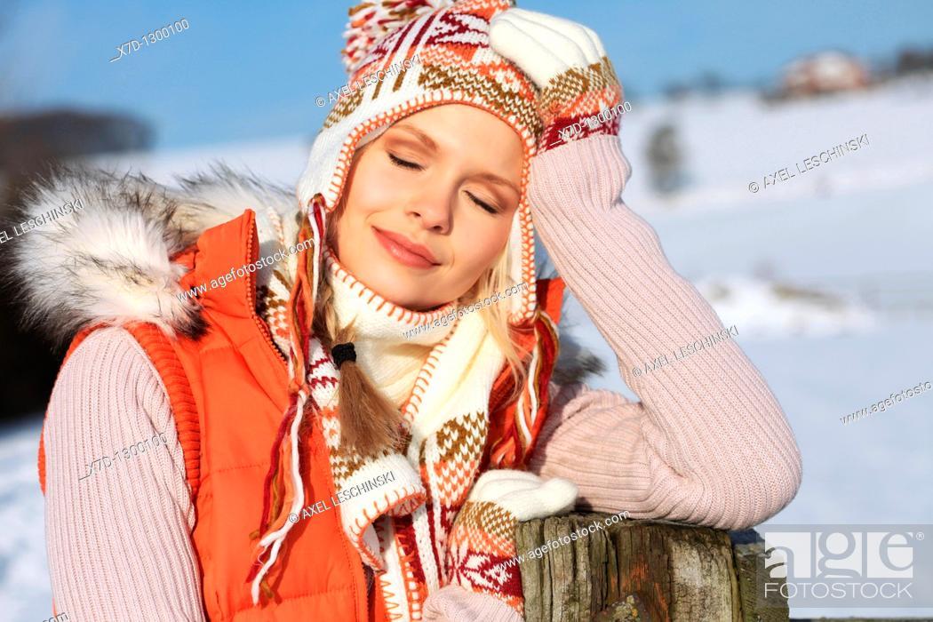 Stock Photo: portrait of woman in winterly landscape.