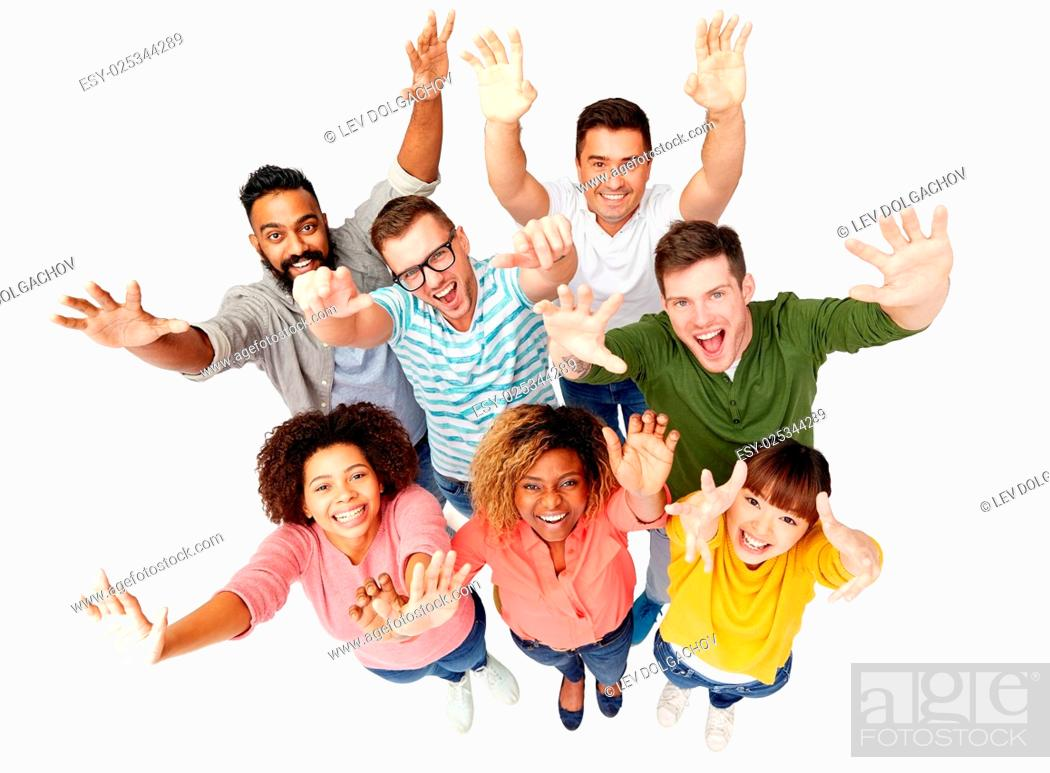 Stock Photo: diversity, race, ethnicity, success and people concept - international group of happy smiling men and women celebrating victory over white.