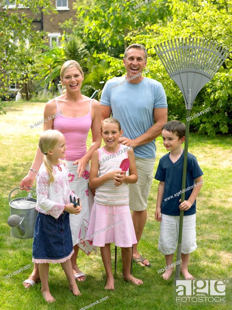 Stock Photo: Family standing in garden.