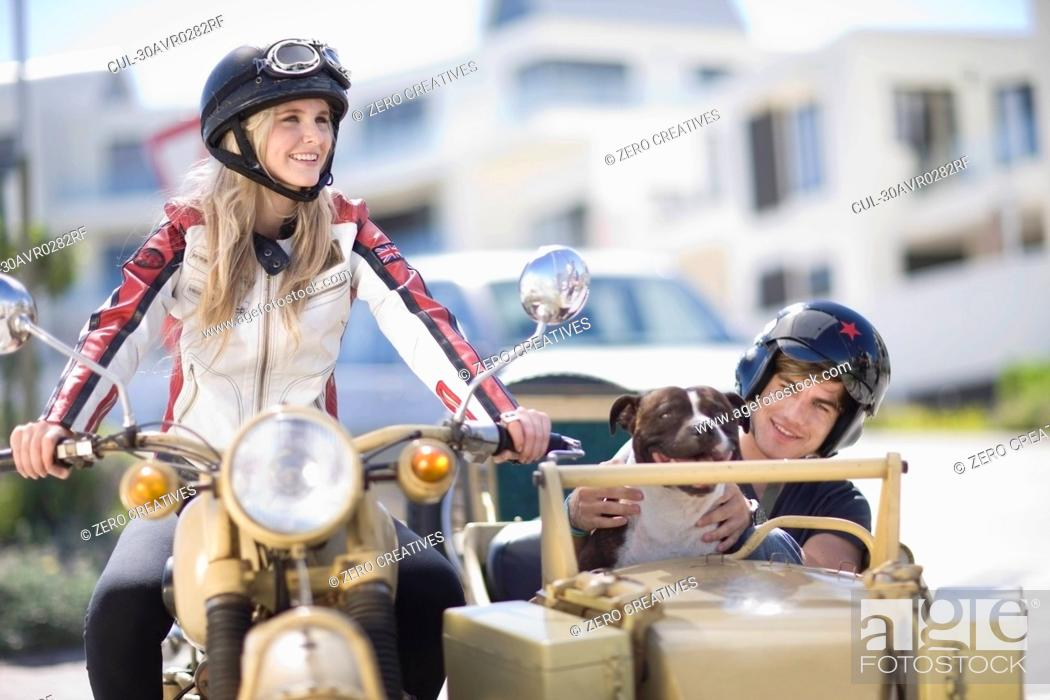 Stock Photo: Couple riding a motorbike.