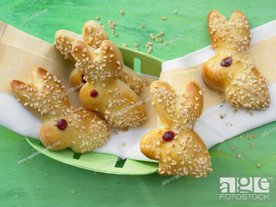 Stock Photo: Yeast dough bunnies with almonds.