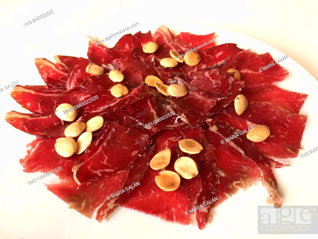 Stock Photo: Cecina with almonds serving. Spain.
