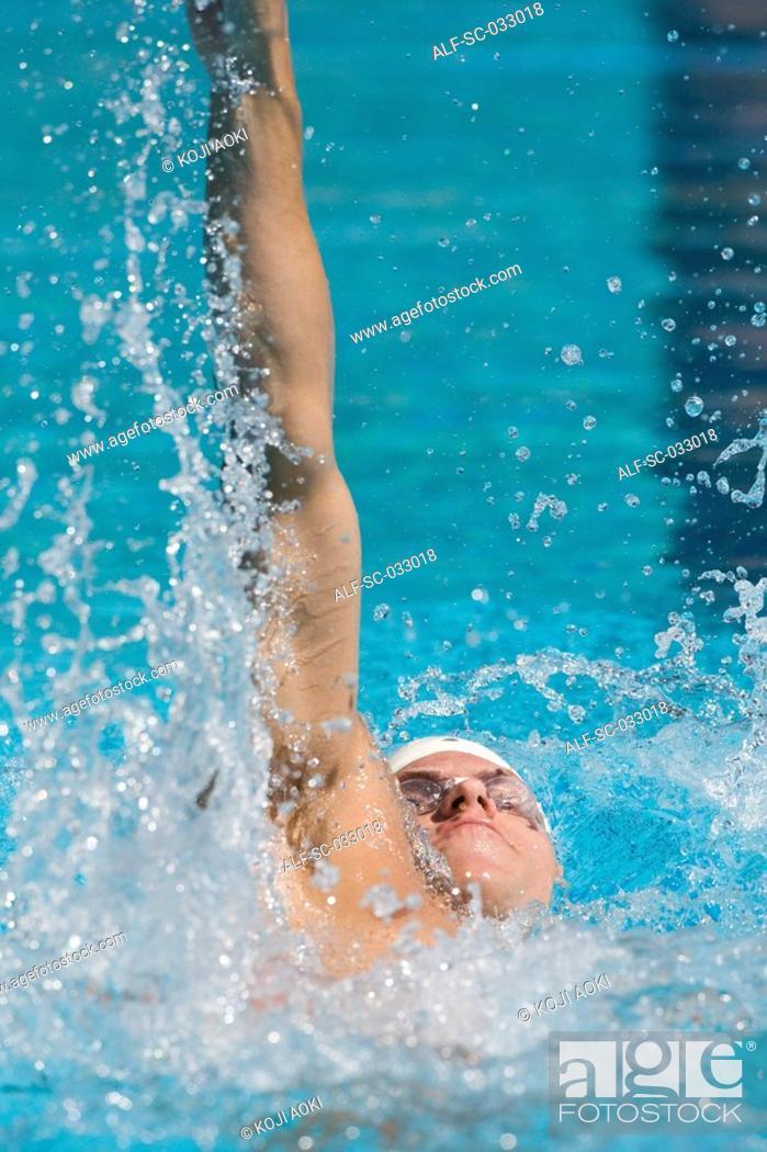 Stock Photo: Australian athlete doing backstroke with back stroke.