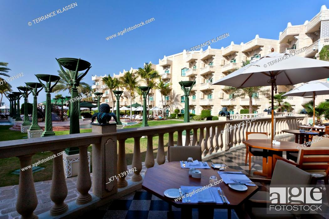 Stock Photo: The exterior patio and pool area of the Grand Hyatt Hotel in Muscat, Oman.
