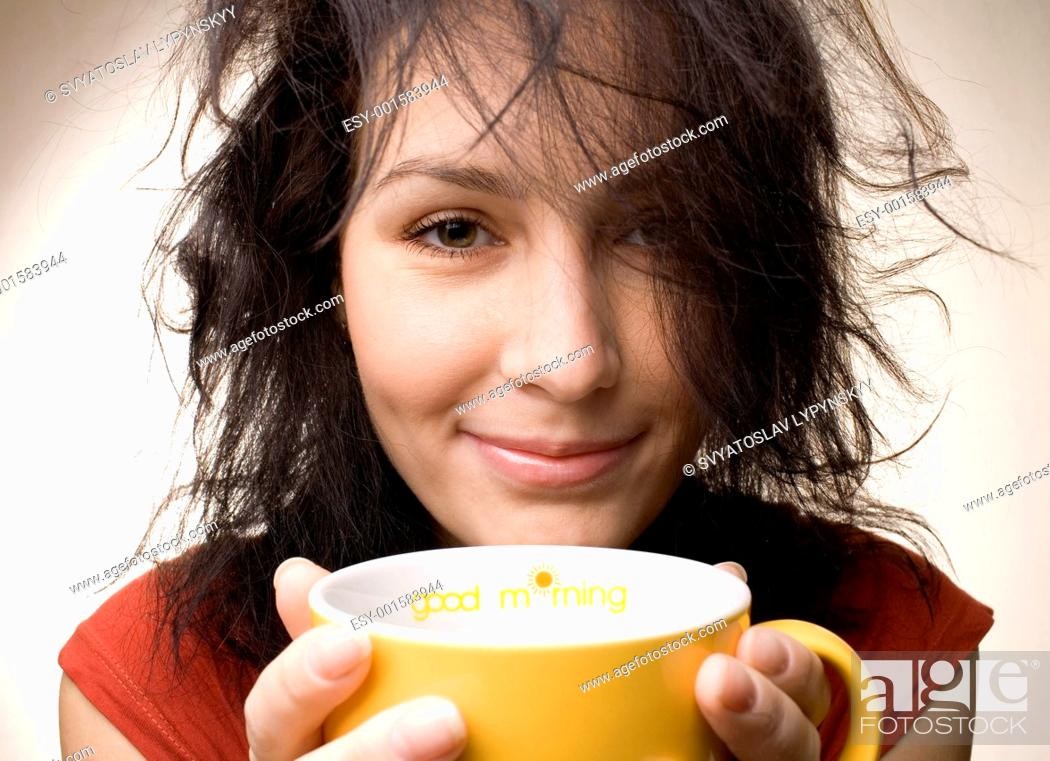 Stock Photo: positive girl with yellow cup.
