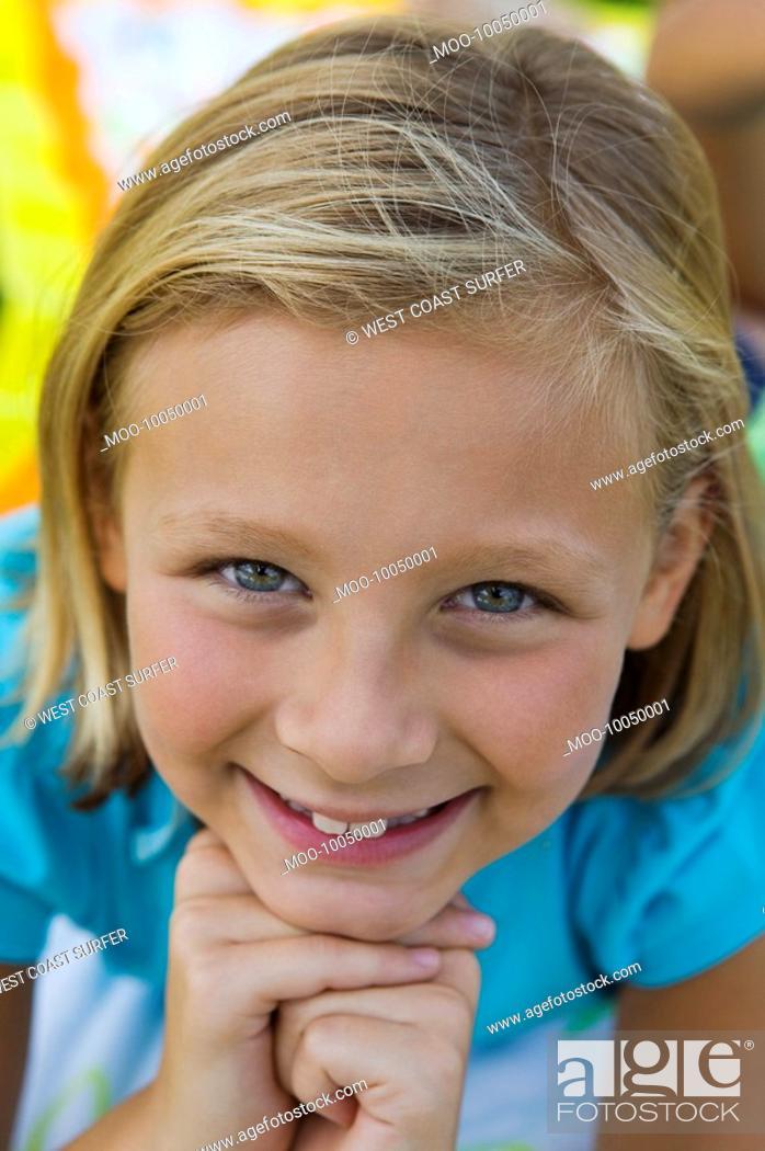 Stock Photo: Smiling girl 7-9 portrait.