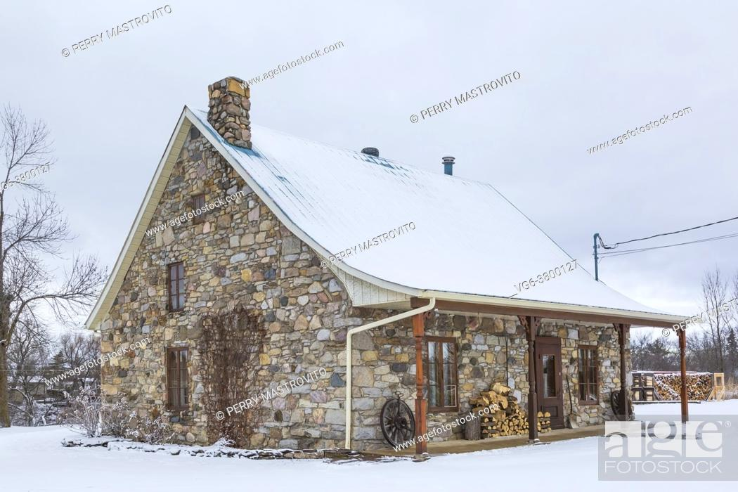 Stock Photo: Old 1807 river and fieldstone cottage style house facade in winter, Quebec, Canada. This image is property released. CUPR0325.