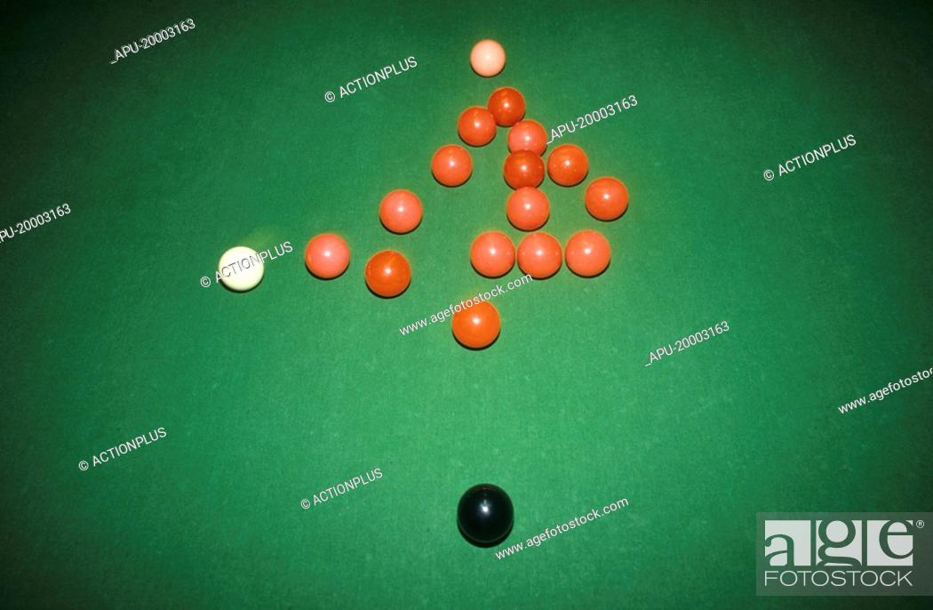 Stock Photo: White ball breaking a rack of snooker balls.