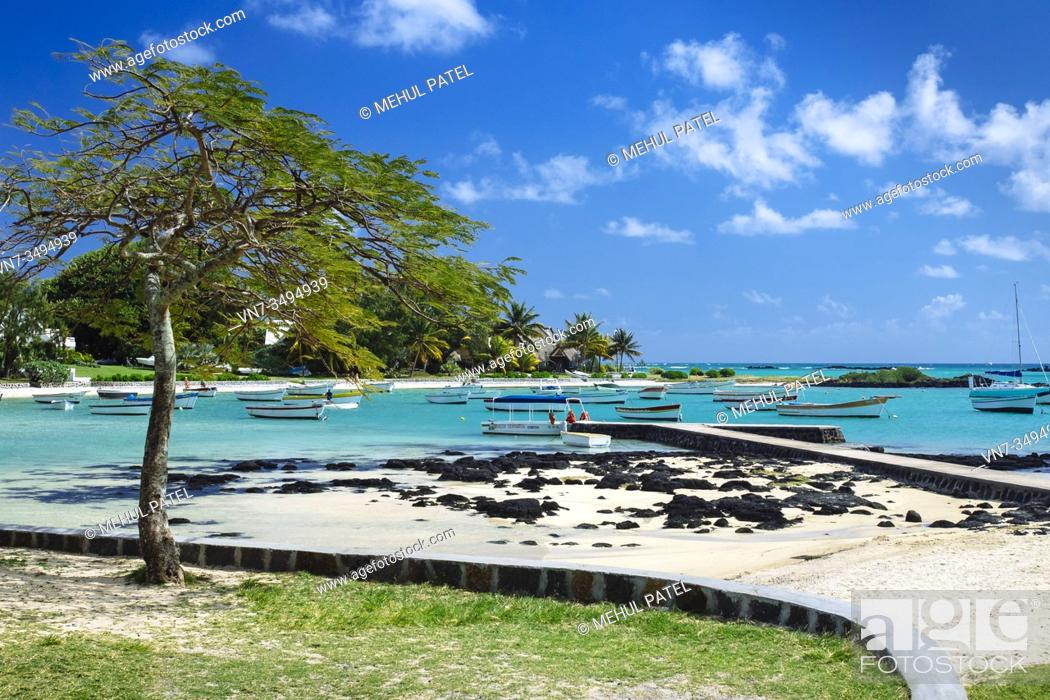 Stock Photo: Boats moored in lagoon of Cap Malheureux, Mauritius, Indian Ocean.