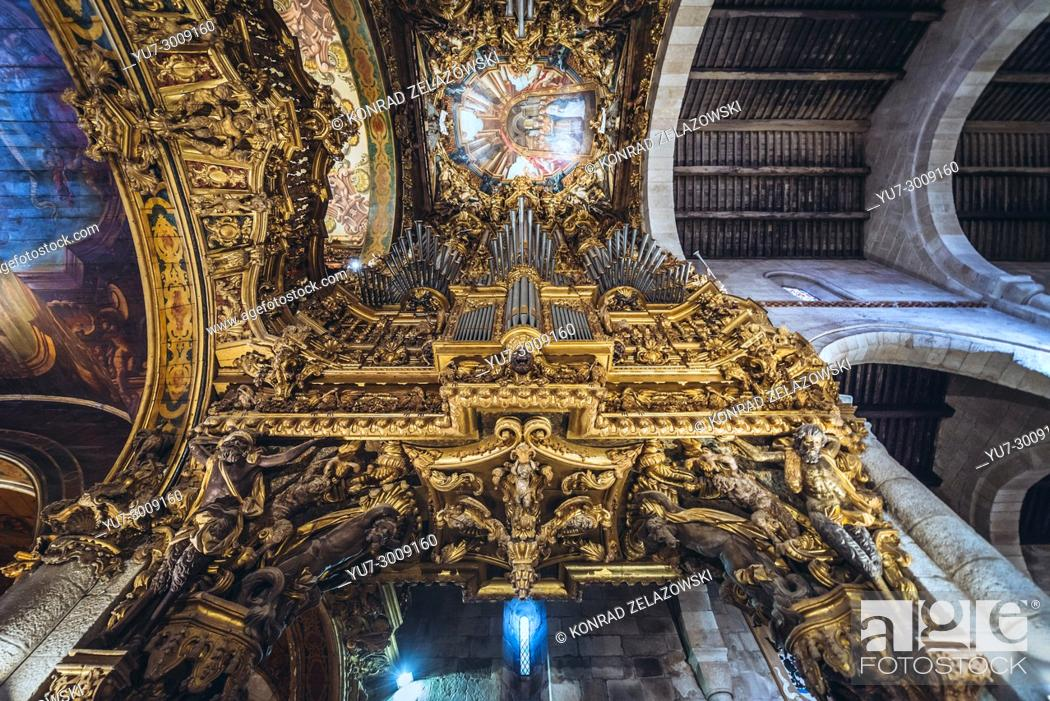 Stock Photo: Heavily decorated organs and ceiling of Cathedral in Braga, one of the oldest cities in Portugal, located in historical Minho Province.