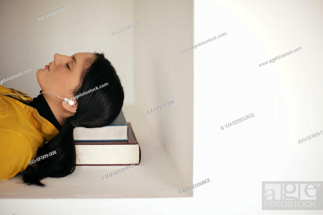 Stock Photo: Young woman asleep on her books.