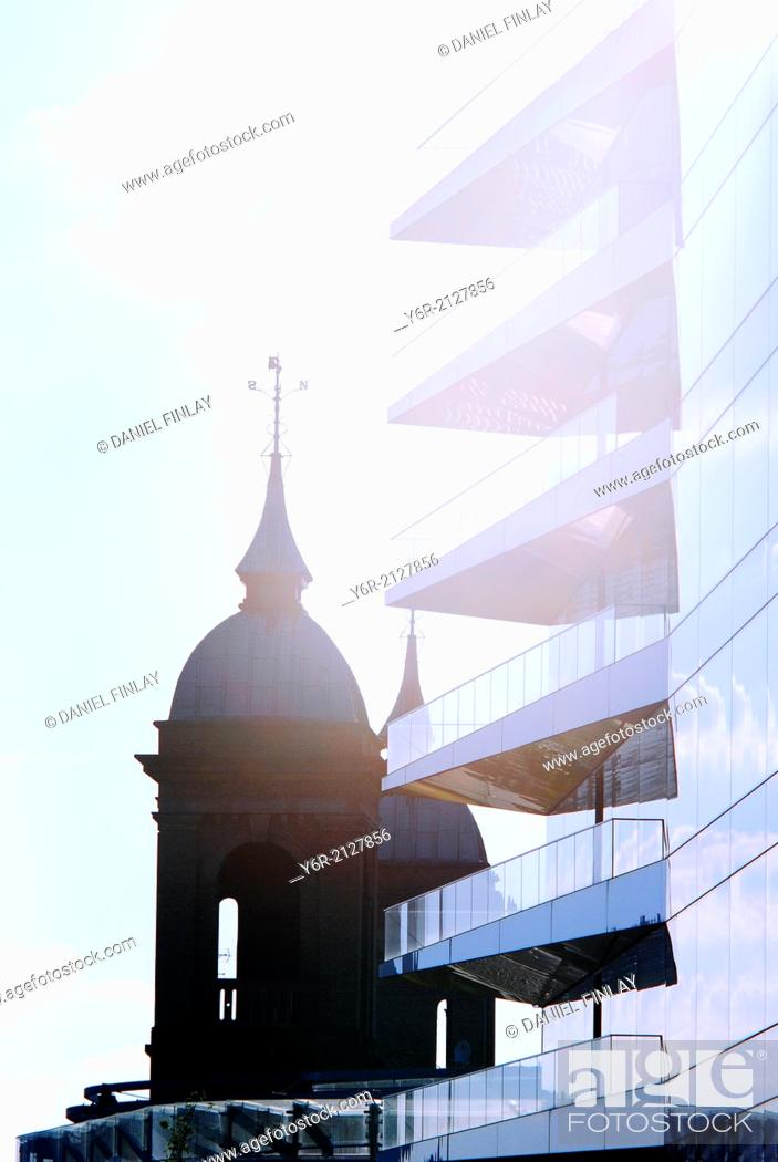 Stock Photo: Buildings in the City of London, England, on the banks of the River Thames caught in strong evening sunlight.