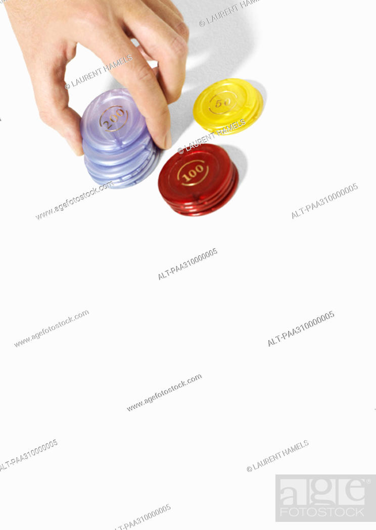 Stock Photo: Hand stacking poker chips.