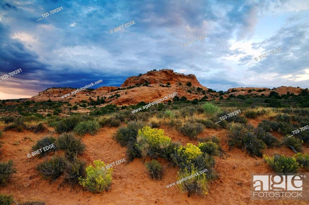 Stock Photo: Storm clouds gather over an unnamed sandstone butte in the Sand Flats area east of Moab, Utah, USA.