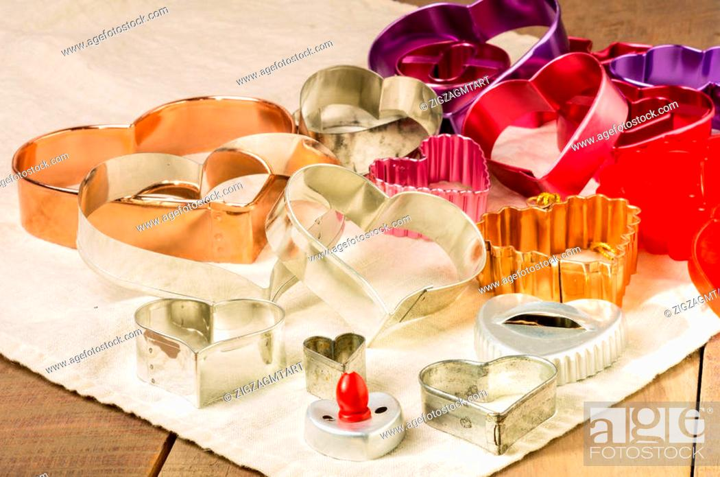 Stock Photo: An assortment of heart shaped cookie or biscuit cutters for Valentine cookiess.