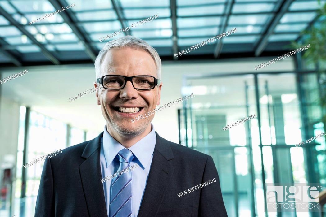 Stock Photo: Germany, Stuttgart, Businessman smiling, portrait.