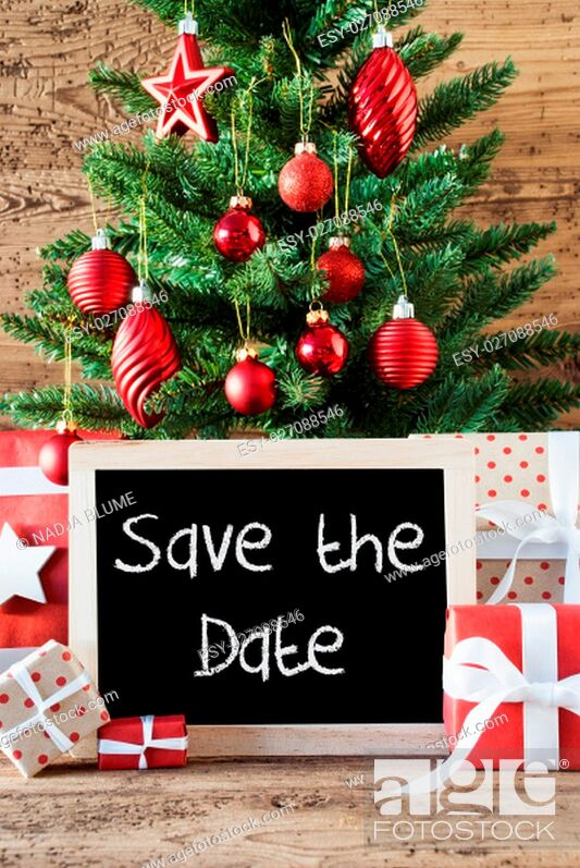 Stock Photo: Chalkboard With English Text Save The Date. Colorful Christmas Card For Seasons Greetings. Christmas Tree With Balls. Gifts Or Presents In The Front Of Wooden.