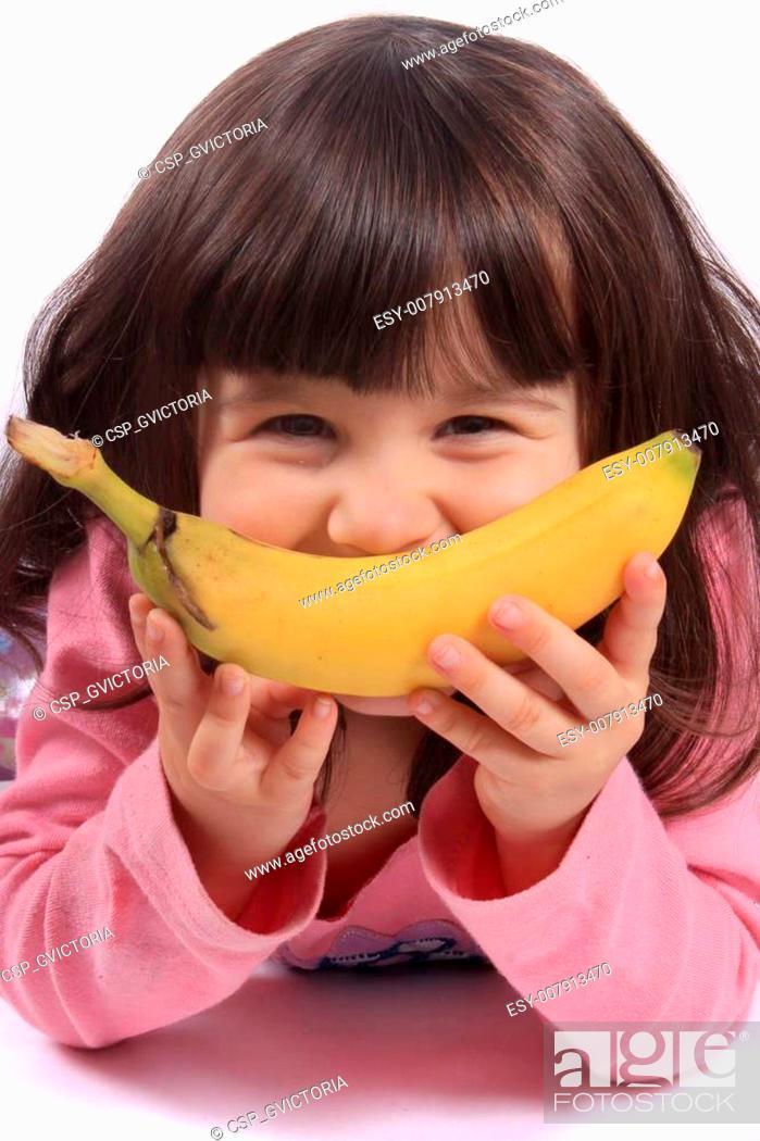 Stock Photo: Little girl with banana smile.