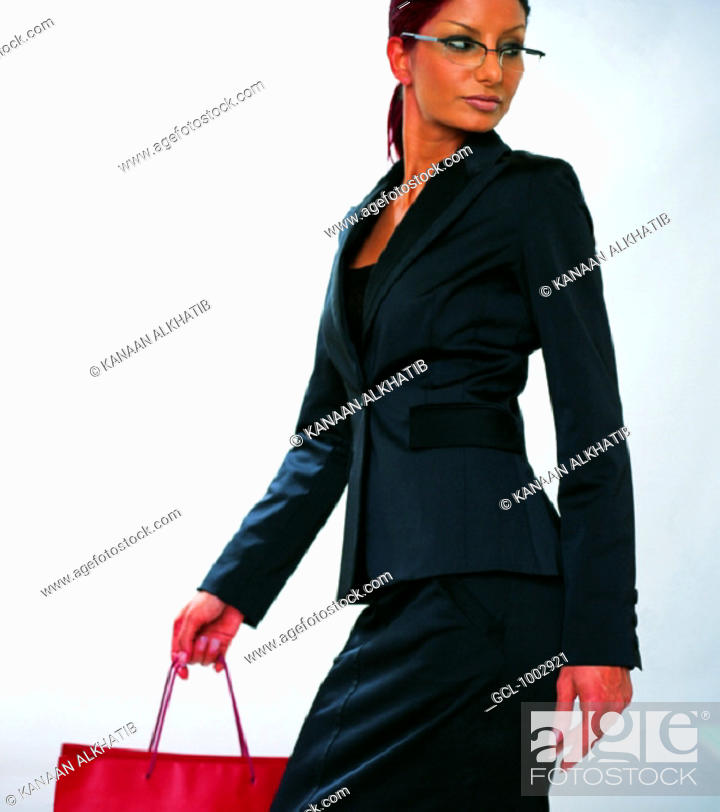 Stock Photo: Woman holding a shopping bag.