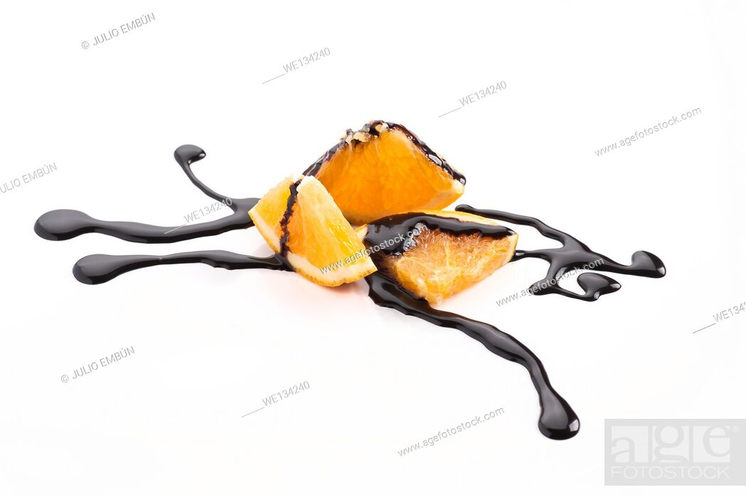 Stock Photo: orange slices with melted chocolate threads.