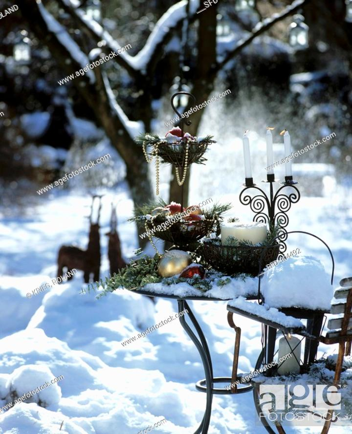 Stock Photo: Table decorated for Christmas in snowy garden.