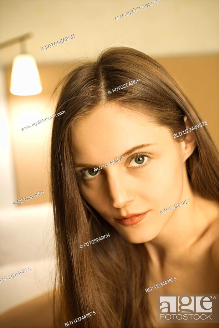 Stock Photo: Portrait of Caucasian woman with long hair looking at viewer.