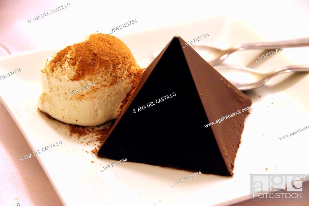 Stock Photo: chocolate pyramid dessert with ice cream.