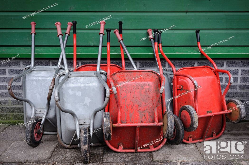 Stock Photo: Wheelbarrows leaning against a wall, Noord Holland, Netherlands.