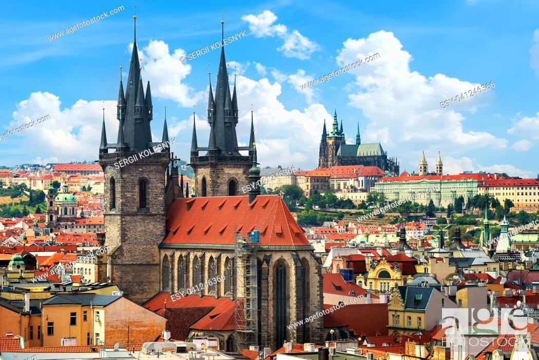 Stock Photo: Tynsky and St Vita cathedrals among the red roofs of Prague. View from above.