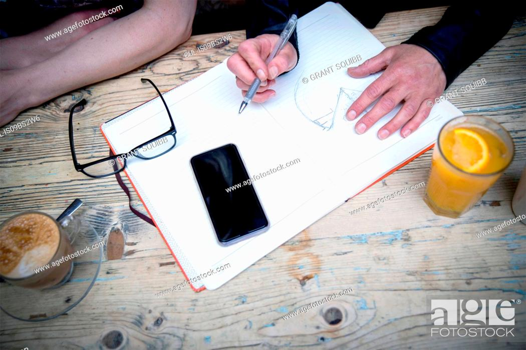 Stock Photo: Business people brainstorming ideas during coffee break.