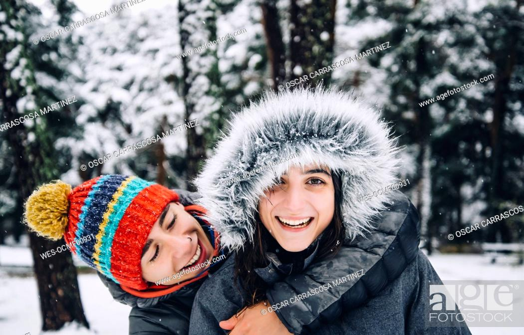 Stock Photo: Portrait of happy young couple in winter forest.