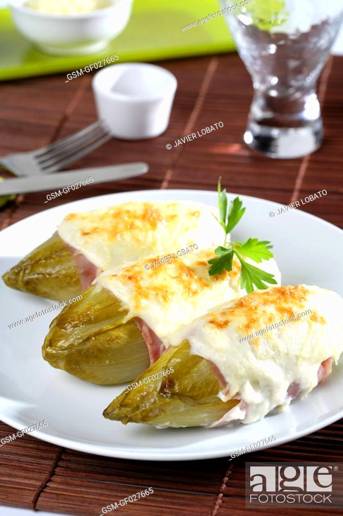 Stock Photo: Endives au gratin with bechamel sauce and cooked ham.