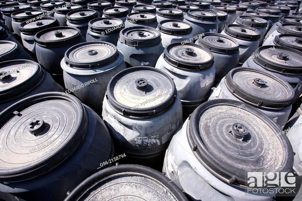 Stock Photo: A group of jerrycans.