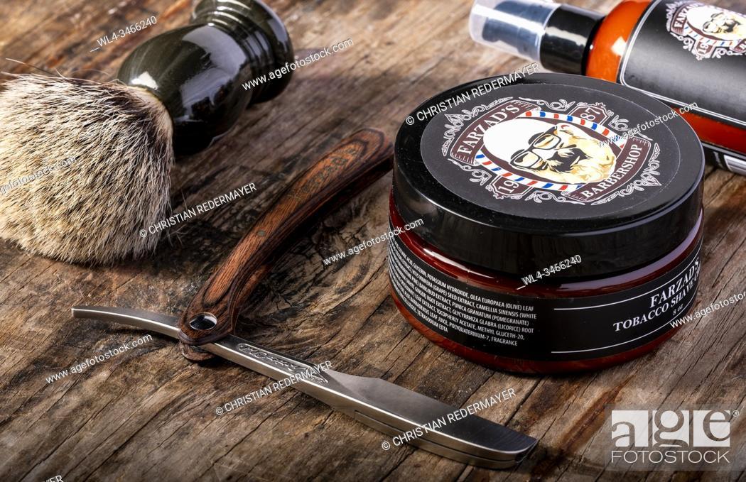 Stock Photo: Men's cosmetics shaving brush and razor on a wooden background.
