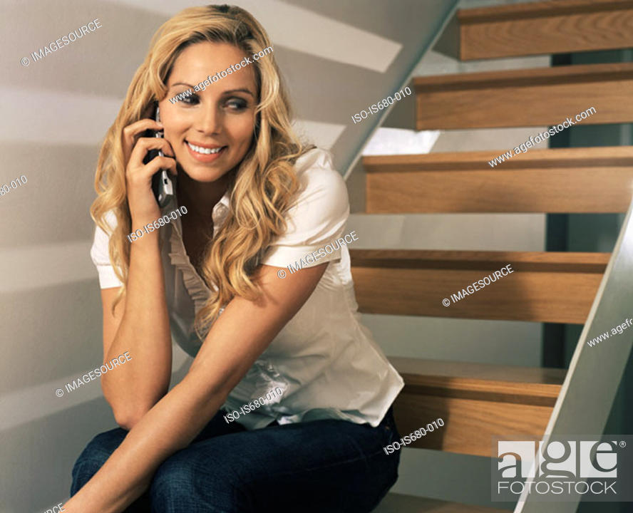 Stock Photo: Young woman on mobile phone.