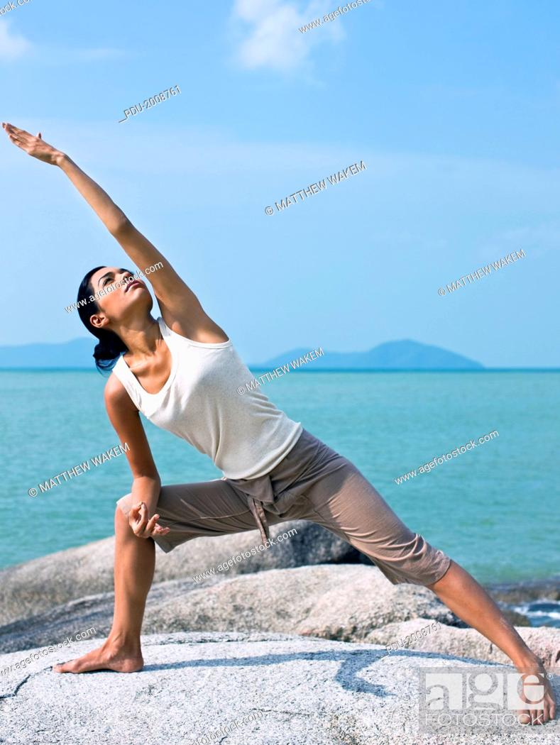 Stock Photo: Woman Practicing Yoga on Beach.