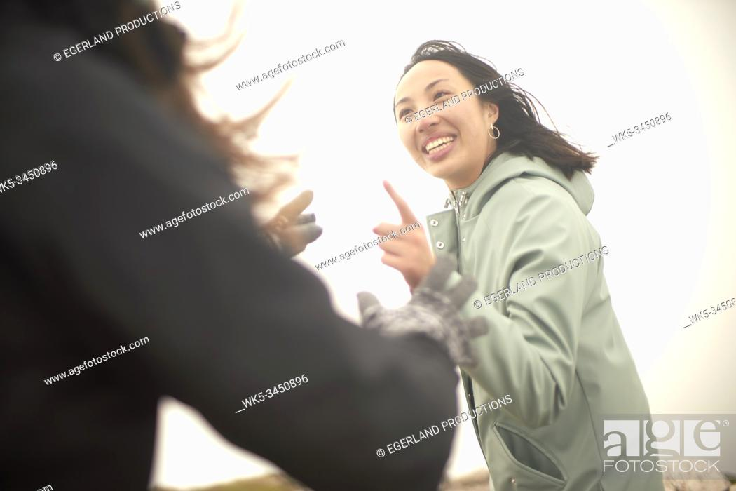 Stock Photo: friends discussing outdoors during hiking trip.