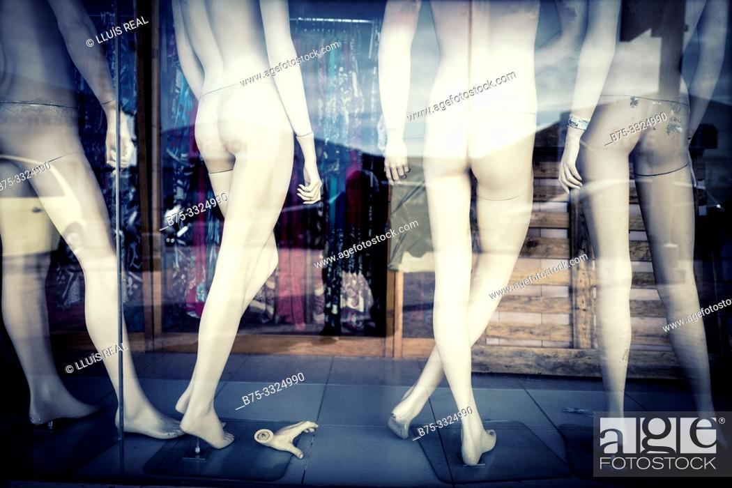 Stock Photo: Back View of naked mannequins in the shop window . Mahon, Balearic Islands, Spain, Europe.