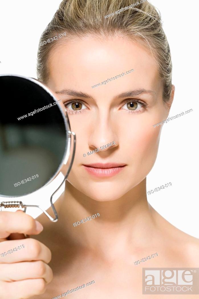 Stock Photo: Woman holding mirror.