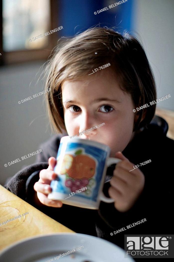 Stock Photo: Child having breakfast, Benbassal, Castellón, Comunidad Valenciana, Spain, Europe.