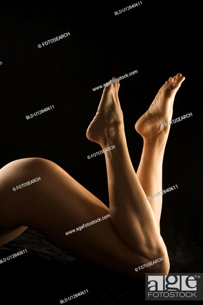 Stock Photo: Nude female lying on stomach.