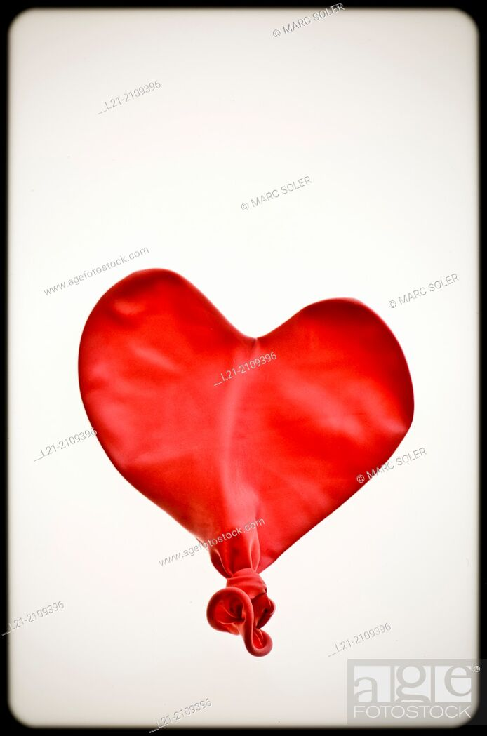 Stock Photo: Studio Shot of deflated red balloon.