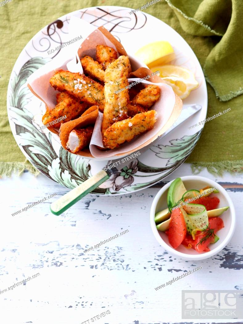 Photo de stock: Plate of fried fish and lemon.