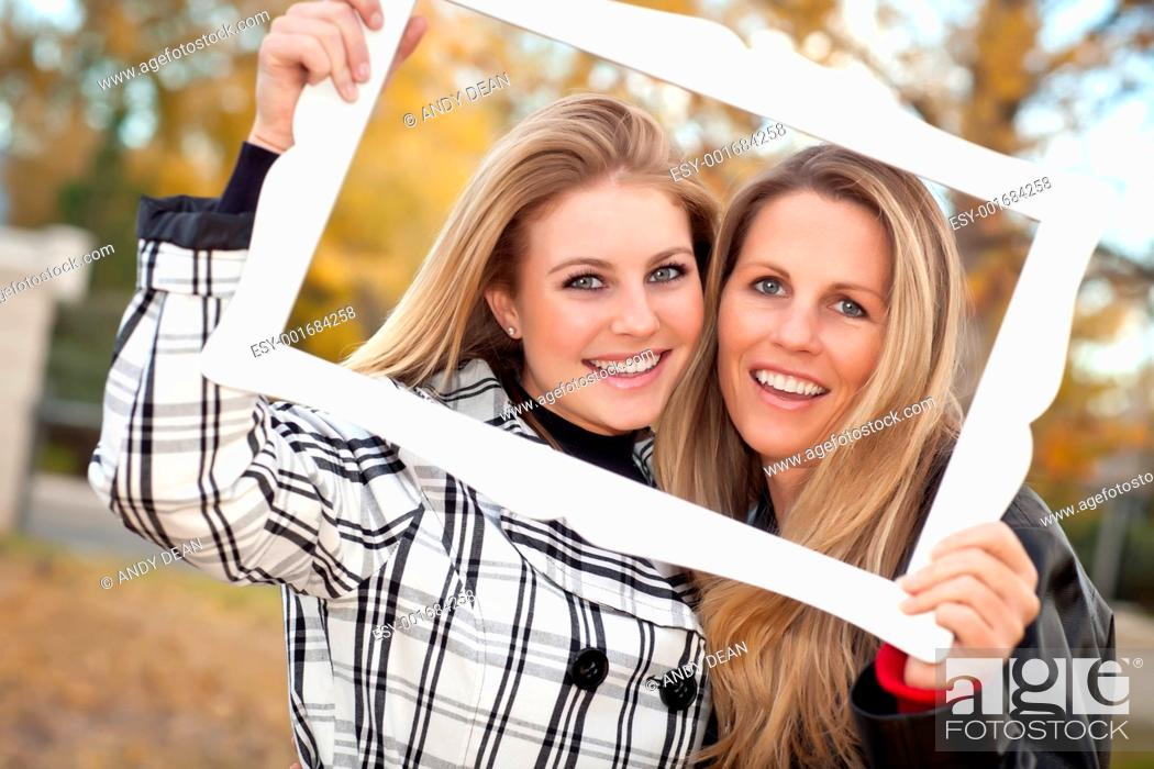 Stock Photo: Pretty Mother and Daughter Portrait in Park with Frame.